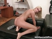 Hot blonde with glasses goes crazy riding on a huge dildo