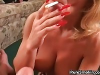 Busty smoking milf gives head