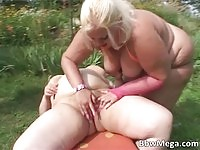 Two filthy BBW babes having sex in nature