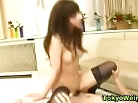 Horny Asian slut in stockings gets a cumshot on her tits