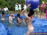 Sweet college teens wrestling in the pool