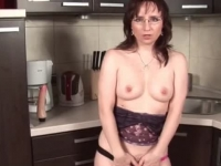 Sexy brunette chick masturbates in the kitchen