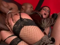 Glam clothed babe fucked in an interracial threesome