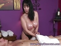 Busty brunette masseuse gives head