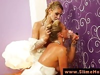 Two blonde brides getting wet and messy by the gloryhole