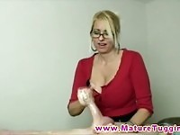 Lusty blonde MILF giving a remarkable handjob