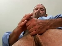 Hairy guy has his cock wanked