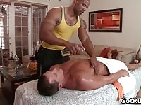 Hot masseur rubbing on a client