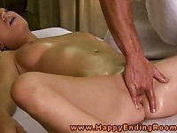 Lovely brunette client fingered by her dirty masseur