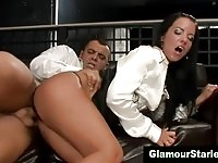 Sexy glam clothed brunette takes a cumshot on the sofa