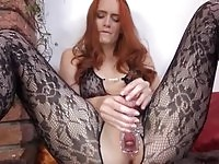 Lusty redhead stretching her cunt just for you