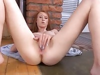 Sexy ginger babe stretching her cunt with those naughty fingers