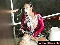 Upper class brunette enjoying her solo bukkake by the gloryhole