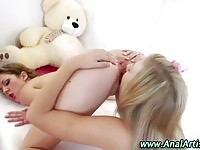 Two sexy teen lesbians toying each others buttholes