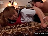 Lovely Japanese schoolgirl gets her pussy fingered