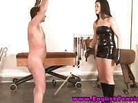 Brunette lady mistress whipping her slave
