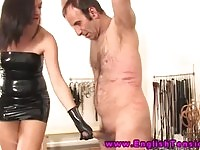 Kinky domina whipping and spanking her obedient slave