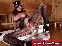 BDSM loving mistress toying her holes