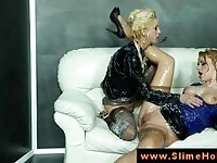 Two delicious glam lesbians getting wet and messy on the sofa