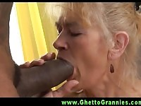 Granny sucking on a large black cock