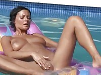 Naughty%20brunette%20toying%20on%20the%20pool