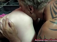 Horny blonde hooker takes a cumshot from a client's dick