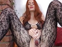 Sexy tall redhead beauty in toying action