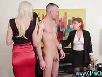 Three hot femdom bitches tugging a naked dude's cock