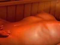 Two amazing lesbian chicks fingering pussies in the sauna