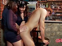 Two kinky dominas fucking a stud's ass with a strapon