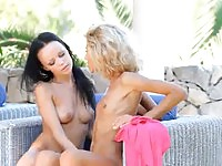 Lovely lesbians toying on a terrace