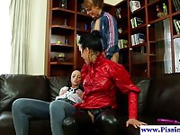 Three naughty lesbians peeing and toying each other