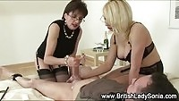 Two aroused MILF dominas tugging their subject's cock