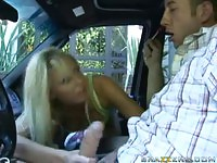 Aroused blonde hottie gives a blowjob in the car