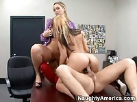 Two astonishing blondes sharing a cock at the office