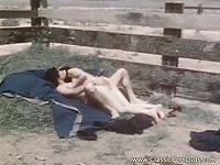 Horny brunette sucking cock outdoors