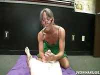 Perverted granny giving a nice handjob while smoking