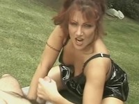 Latex slut gives handjob in the backyard
