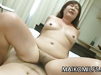 Chubby Asian MILF sucks and rides a young cock