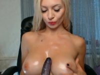 Lusty blonde amateur takes a dildo on webcam