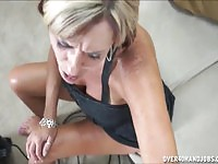 Hot MILF tugging her step son's cock