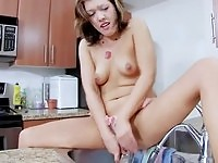 Really horny doll Brooke goes solo in the kitchen