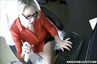 Horny MILF secretary tugs a fat cock at the office