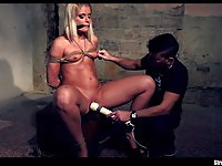 Sexy blonde slave squirting after a forced orgasm