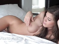 Incredible beauty rubbing her tight shaved pussy