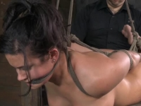 Busty brunette slave gets punished