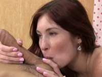Freakled redhead beauty plays with cock