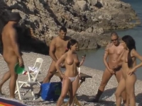 A bunch of nude swingers having an orgy on the beach