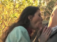 Sexy brunette sucking on a cowboy