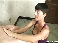 Brunette short haired nurse helping the dude with a handjob
